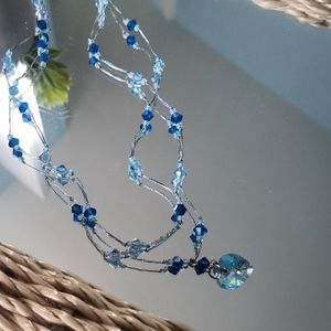 Swarovski crystal bead and silk thread necklace